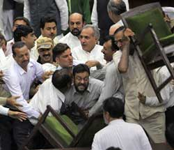 PDP MLAs disrupt the proceedings in the legislative assembly by throwing chairs towards the treasury benches while protesting against the Inter-district Recruitment Bill, in Jammu on Friday. PTI Photo