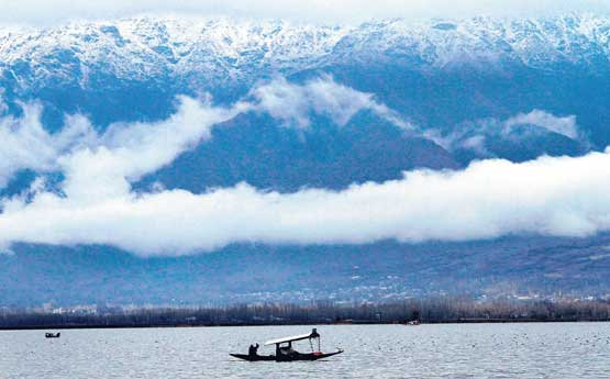 Snow covered mountains are seen in the backdrop of the Dal Lake in Srinagar. File photo. AP