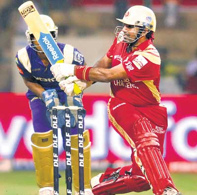 BIG HITTER: Royal Challengers Bangalore's Robin Uthappa reverse sweeps Ajantha Mendis to a six during his quickfire 52 against Kolkata Knight Riders at the M Chinnaswamy stadium on Saturday. DH PHOTO/ SRIKANTA SHARMA R