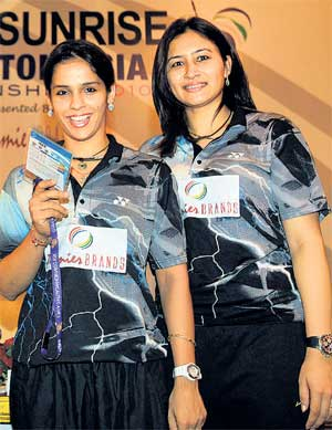 ACE DUO: Badminton players Saina Nehwal (left) and Jwala Gutta pose during a press meet on the eve of the Asian Championships beginning in New Delhi on Monday. PTI