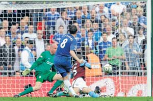 On target: Frank Lampard scores Chelsea's third goal during their 3-0 rout of Aston Villa in the FA Cup semifinal at the Wembley stadium in London on Saturday. AP