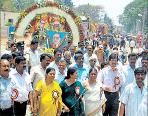 Respect: Deputy Commissioner N Prabhakar at the tableaux procession organised by district administration.DH Photo