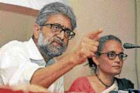 Human Rights activist Gautam Navalakha and eminent writer and social activist Arundhati Roy jointly address a press conference on operation Green Hunt in Kolkata on Wednesday. PTI
