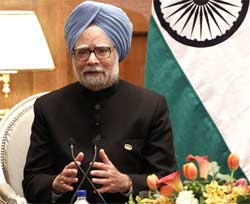 Prime Minister Manmohan Singh speaks during a news conference in Washington on Tuesday. AP