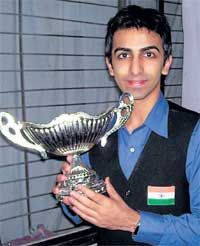 Brilliant win: Pankaj Advani poses with the trophy after winning the Asian Billards Championships on Thursday.