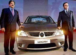 File picture of Renault & Nissan CEO Carlos Ghosn (right) and M&M MD Anand Mahindra with the Logan car. AFP