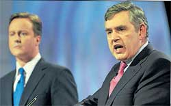 British Prime Minister Gordon Brown (right) and leader of opposition David Cameron at a live TV debate on Thursday. AFP