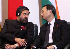 Union Minister of Commerce and Industry Anand Sharma has a word with Chinese Foreign Minister Yang Jiechi at the BRIC Summit in Brasilia, Brazil, on Thursday. PTI