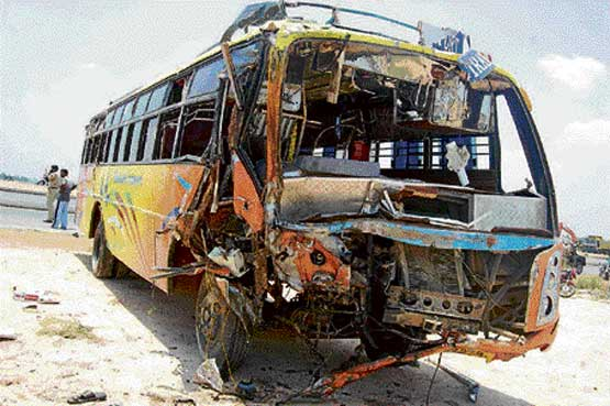 The mangled remains of the private bus that met with an accident near Kolar on Saturday. DH photo
