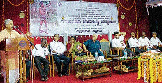Folk expert and Kannada University former VC Dr Chandrashekar Kambar speaking at the second tribal convention in Karkala on Saturday.  DH Photo