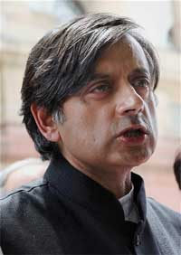 Minister of State for External Affairs Shashi Tharoor talks to the media at the Parliament House in New Delhi on Friday. PTI