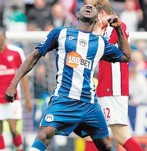 KILLER BLOW: Wigan Athletic's Steve Gohouri exults after his team scored a shock win over Arsenal in their English Premier League match on Sunday. AP