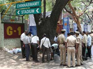 Bomb diffuser squad and policemen inspect the site where they found another bomb on the main gate of Chinnaswamy stadium in Bangalore on Sunday. PTI