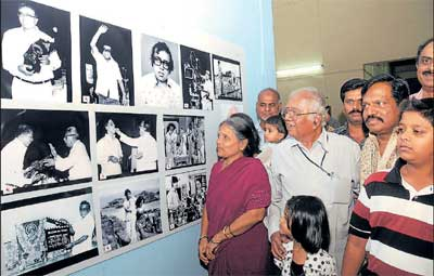 Nostalgic: Geethapriya taking a look at the photographs with his wife.