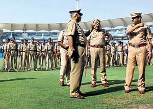 Vvigilant: Policemen assess the security arrangements at the DY Patil Stadium at Mumbai on Monday ahead of the IPL III semifinal matches . PTI