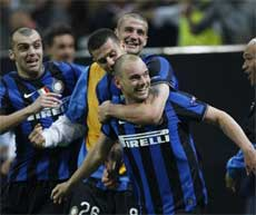 Inter Milan Dutch midfielder Wesley Sneijder, right, celebrates with teammates forward Goran Pandev of Macedonia, left, Brazilian midfielder Thiago Motta and Inter Milan Romanian defender Cristian Chivu after Argentine forward Diego Milito, not in photo, scored during a Champions League semifinal first leg soccer match between Inter Milan and Barcelona at the San Siro stadium in Milan, Italy on Tuesday. AP