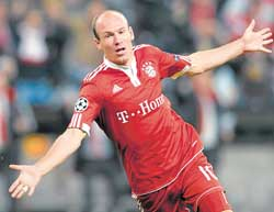 ON A HIGH: Bayern's Arjen Robben celebrates after scoring against Lyon in the Champions League on Wednesday. APON A HIGH: Bayern's Arjen Robben celebrates after scoring against Lyon in the Champions League on Wednesday. AP