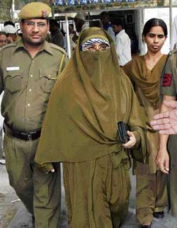 Farida Dar, the lone woman convict in the 1996 Lajpat Nagar blast case, walks free out of the court, in New Delhi on Thursday. pti