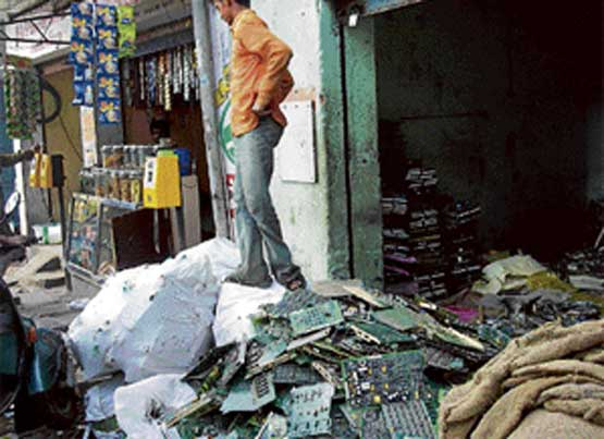 E-waste piled up in the shop of a scrap dealer.