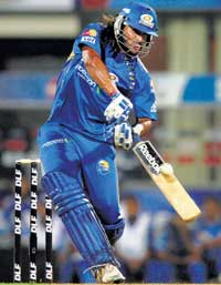 MATCH WINNER: Mumbai Indians' Saurabh Tiwary hits a boundary during his unbeaten knock of 52 against Royal Challengers Bangalore in the IPL semifinal on Wednesday. PTI