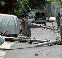 The electric poles brought down by heavy rains and gusting winds on Wednesday, in Basaveswaranagar. dh photo