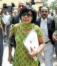 making a statement: Senior IPS officer Anju Gupta comes out after deposing before the special Raebareli court in the Babri Masjid demolition case on Friday. pti