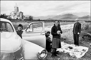 On the road: Cartier-Bresson's 'The Modern Century'. A 1972 photo of a Georgian family picnicking near a monastery.