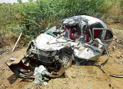 Mangled remains of a car involved in the accident near Halageri.