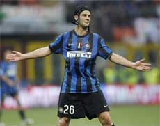 Inter Milan Romanian defender Cristian Chivu celebrates after scoring during a Serie A soccer match between Inter Milan and Atalanta, at the San Siro stadium in Milan on Saturday. AP