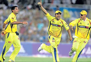 Chennai Super Kings' Suresh Raina (centre) celebrates the dismissal of Mumbai Indians' Saurabh Tiwary with Mathew Hayden (R) and another teammate during the IPL-3 final match in Navi Mumbai on Sunday. PTI