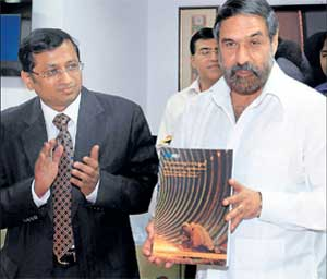 Union Minister for Commerce and Industry Anand Sharma releasing a strategy paper on engineering exports as EEPC India Vice Chairman Anupam Shah looks on in New Delhi on Tuesday. PTI