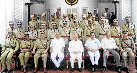 Governor H R Bhardwaj, Chief Minister B S Yeddyurappa and Home Minister V S Acharya with police officers after the Police Investiture Ceremony in Bangalore on Monday. dh photo