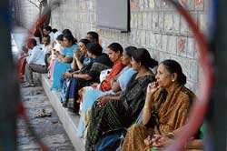 testing times for them too: Parents waiting outside the CET exam centre at Baldwin Methodist College in Bangalore on Wednesday. dh Photo