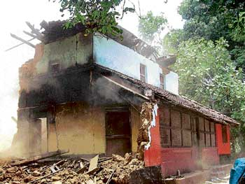 use of force: The demolished house of Gregory Patrao at Kalavar village in Surathkal. dh photo