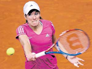 Belgium's Justine Henin returns to Julia Goerges   during their first-round match at the Stuttgart Open. AFP