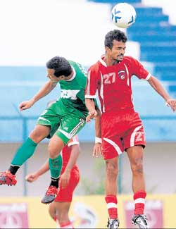 HASC's Jotin Singh (left) and Malabar United's PU Vijesh Kumar vie for the ball in their I-League Second Division final round match on Friday. DH Photo