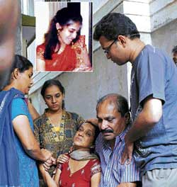 inconsolable: Grieving relatives of Rajani Rajan (inset) murdered in Ganganagar on Friday. dh photo