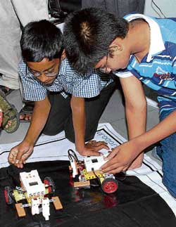 In deep focus: Children at the Robotics camp, launched by Reliance World in association with an IIT-incubated company, in Bangalore on Friday.  DH Photo