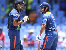 Indian captain MS Dhoni (R) and Yuvraj Singh during the match against Afghanistan on Saturday. AFP