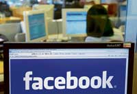 Mark Zuckerberg, a founder of Facebook,  says it has  sophisticated ways to defeat fake accounts. REUTERS