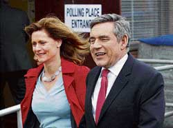 Prime Minister Gordon Brown arrives with wife Sarah to a polling station in North Queensferry in Fife,  Scotland. Reuters