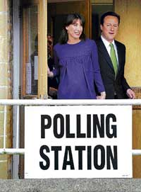 Britain's opposition Conservative Party leader David Cameron and wife Samantha leave after voting at a polling station near Witney in Oxfordshire in southern England on Thursday. Reuters