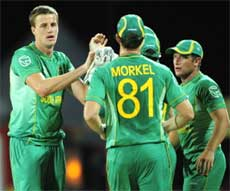 South African bowler Morne Morkel (left) celebrates with teammates the dismissal of Afghan batsman Karim Sadiq during the World Twenty20 at the Kensington Oval on Wednesday. AFP