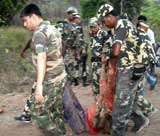 Security personnel at the scene of landmine blast which killed seven, in Pedakodepal in Chhattisgarh on Saturday. AFP