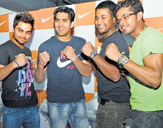 ALL SMILES: From left: Indian cricketers Virat Kohli, Pragyan Ojha and S Sreesanth alongwith boxer Vijender Singh (second from left) pose during a promotional event on Saturday. DH photo