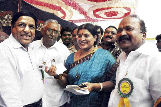 Outgoing president Jayamala congratulating the newly-elected president Basanth Kumar Patil after Karnataka Film Chamber of Commerce election in Bangalore on Saturday. DH photo