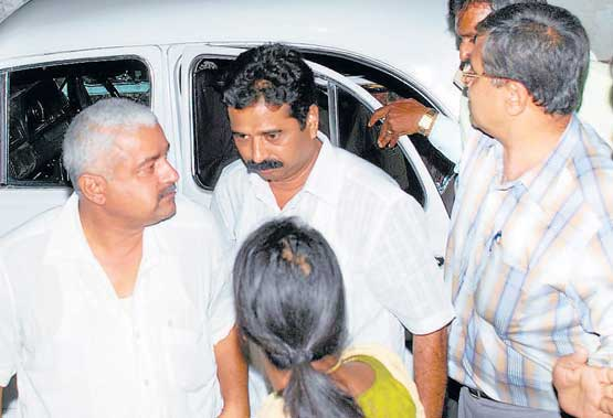 GUILTY OR INNOCENT: Former minister H Halappa taken to hospital by CID police in Shimoga on Sunday. DH PHOTO