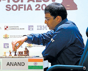 Champ again: Anand makes a move in the 12th game. AP