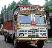 A truck owner has to pay Rs 20,000 annually.