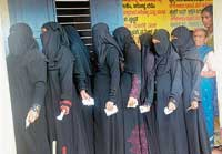 Women waiting in a queue to excercise their franchise at a polling booth in Mangalore on Wednesday.  dh photo